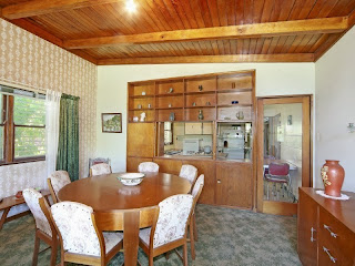 1960s dining room with original feltex carpet and built ins