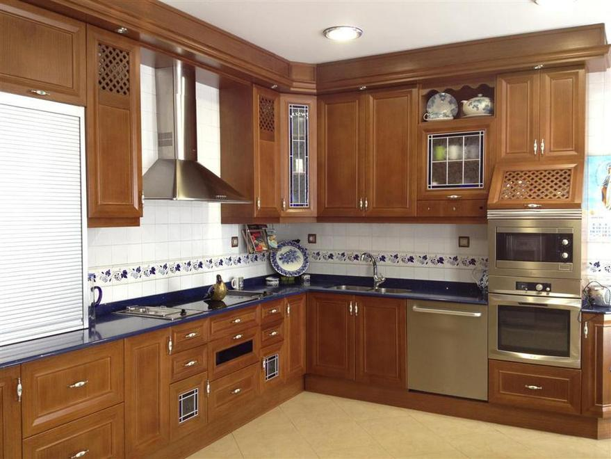 Muebles de cocina a medida carpinteros en m laga y for Cocinas muebles a medida