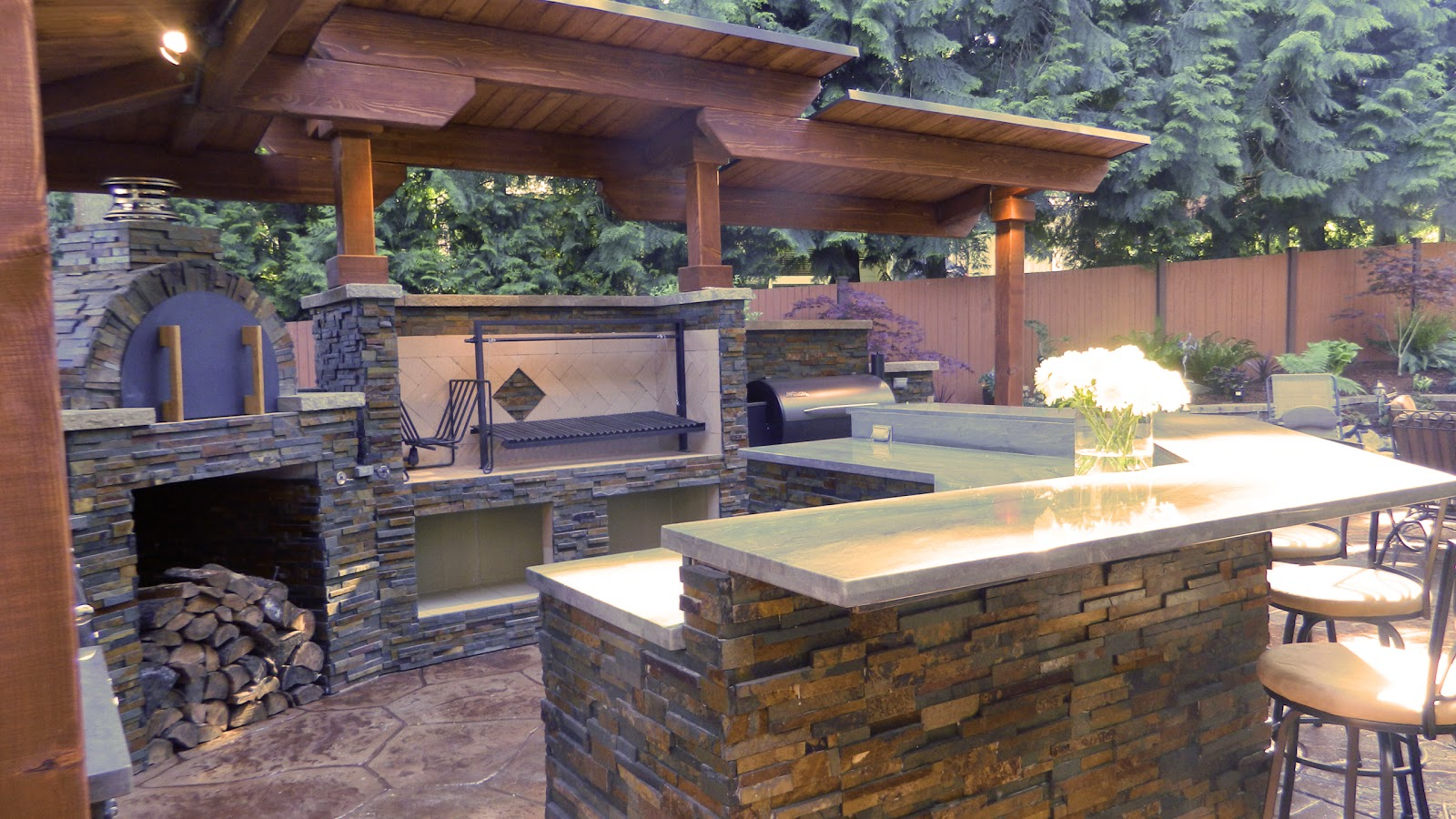 outdoor kitchen with argentinian grill brickwood pizza