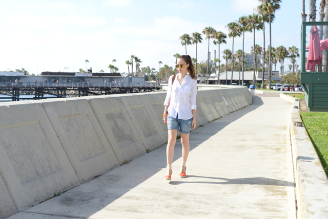 walking along the boardwalk in a linen top and jean shorts via M Loves M