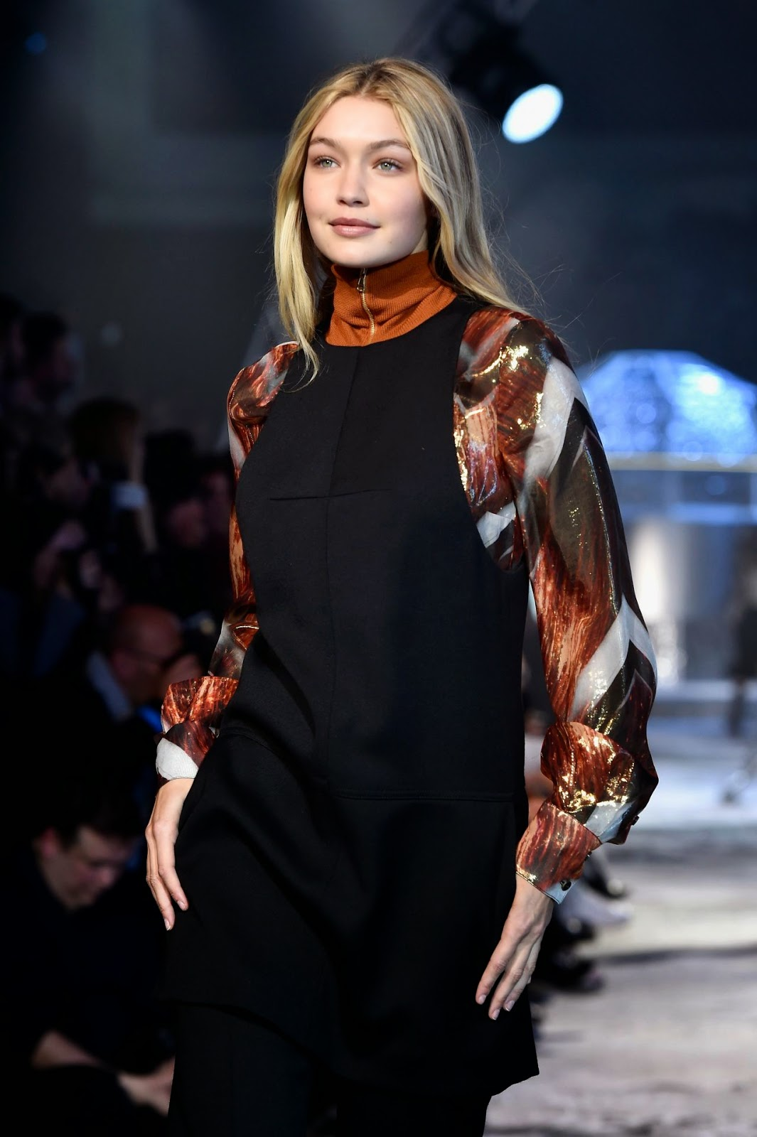 Gigi Hadid flaunts demure styles at the H&M Paris Fashion Week Show