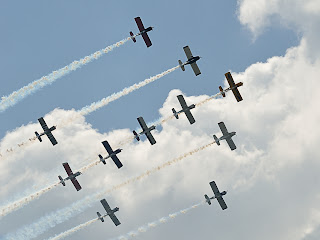 picture of all eleven planes from Team RV at the Evansville Freedom Festival flying in close formation