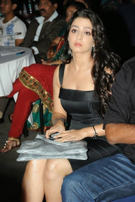 charmi kaur hot cleavage and milky legs black dress pics