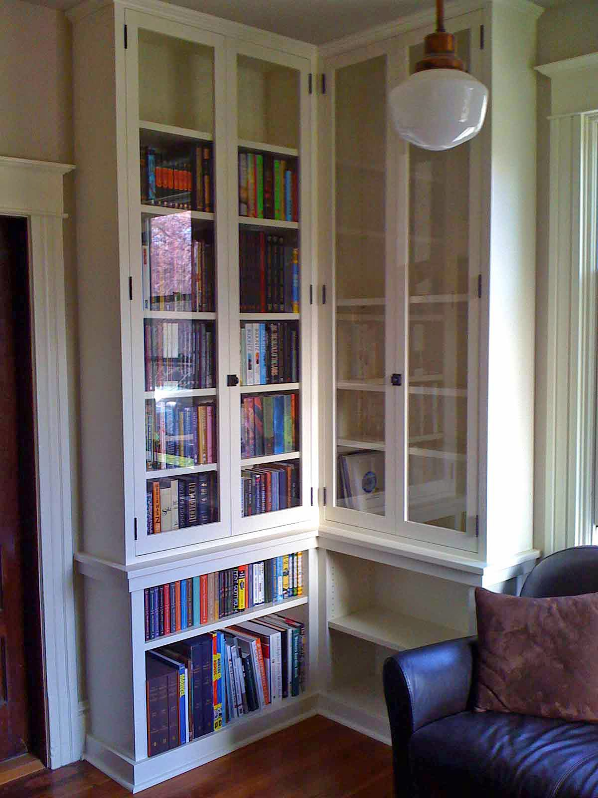 344 Tall glass doors on floor to ceiling built in bookcase