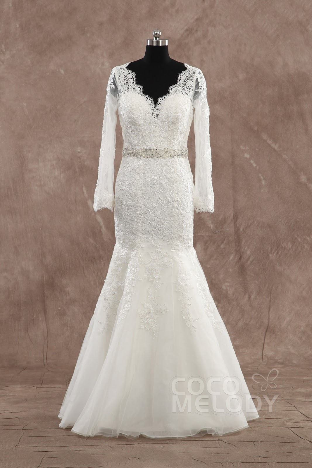 http://www.cocomelody.com/sparkle-trumpet-mermaid-v-neck-dropped-train-lace-ivory-long-sleeve-open-back-wedding-dress-with-sashes-and-appliques-cwat1400c.html