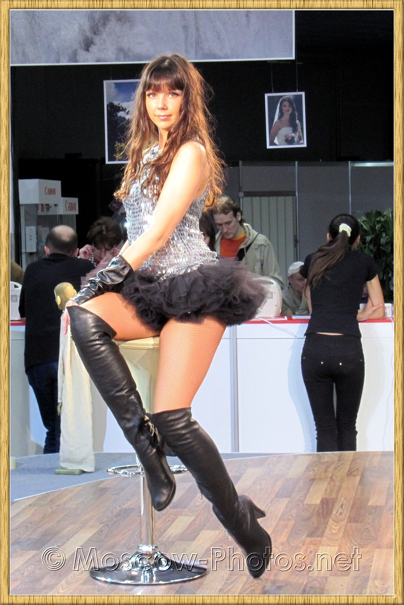 Beautiful long-haired girl in black boots at Photoforum 2010