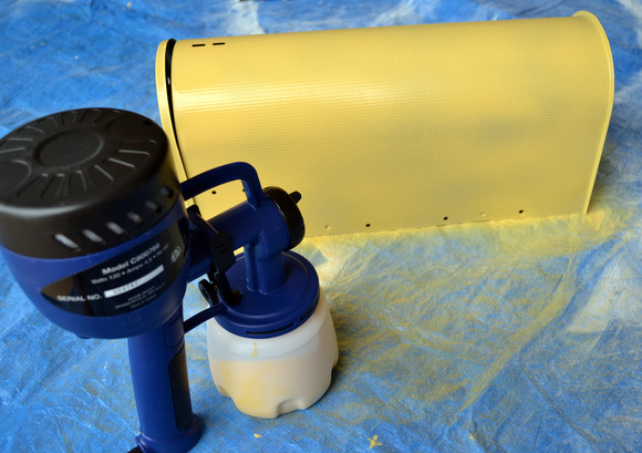 Yellow Mailbox and Paint Sprayer