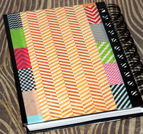 Journal decorated with scrapbook papers and decorative tape