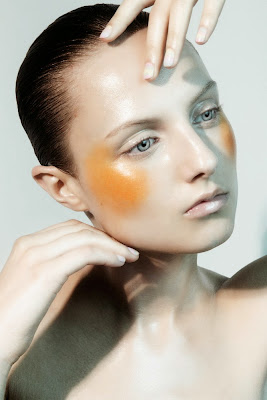woman with orange blush, shiny skin, nyc beauty photography
