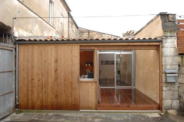 Reforma de un garaje como vivienda|Espacios en madera