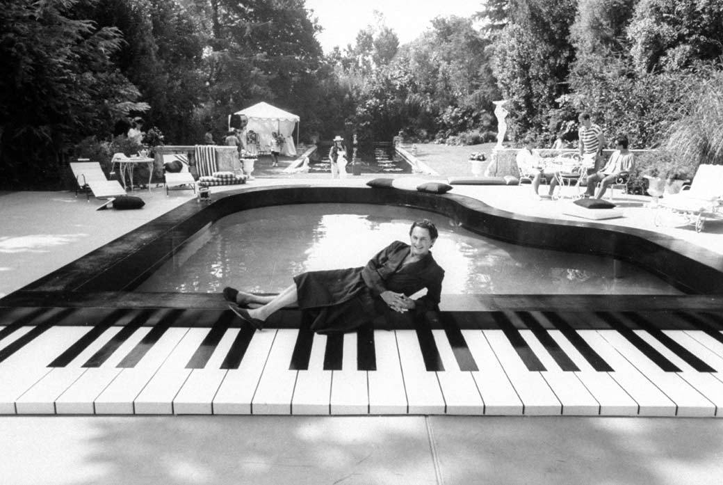 crazy shape swimming pools piano swimming pool in usa actor victor garber star of cbs tv movie liberace behind the music lounging in front of a piano