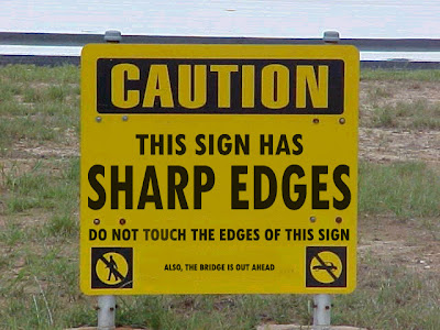[Big print]Caution: this sign has sharp edges; do not touch...