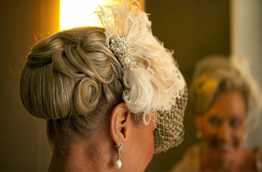 wedding hairstyle brown color unpdo with flower