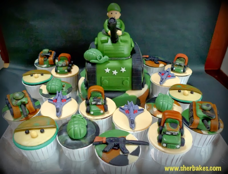 birthday consists of an army tank cake on top of a base cake with army ...