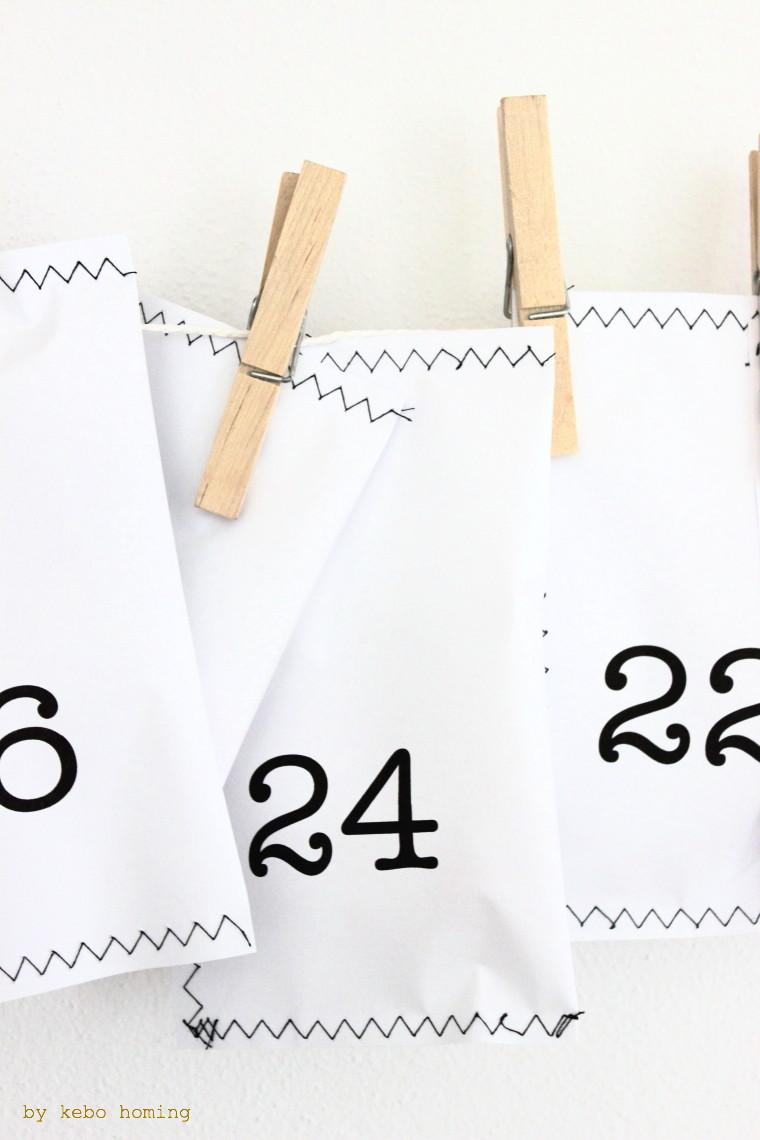 Adventskalender DIY aus selbst genähten Tüten mit Anleitung auf dem Südtiroler Blog kebo homing, skandinavischer Wohnstil, minimalistisch, Gold, Weiß und Schwarze Dekoration für den Advent