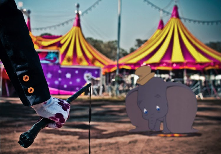 Dumbo being whipped bloody by a circus handler