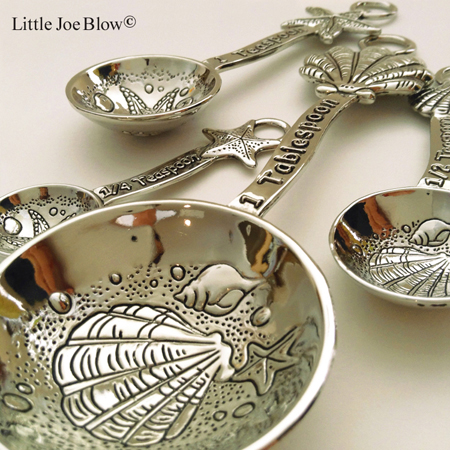 clamshell shell measuring cups sold on http://littlejoeblow.com/SHELLS-measuring-spoons-ganz.html by Little Joe Blow Ind.