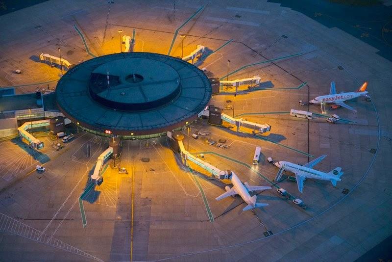 Planes awaiting take off at Gatwick Airport Terminal at night.