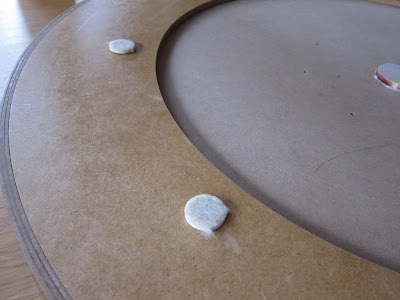 Crokinole - The felt feet, to cover the countersunk screws and protect table surfaces