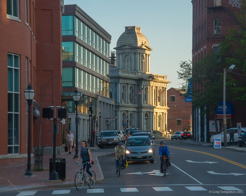 Fore and Franklin Streets in Portland, Maine USA Bicyclists and Custom House in the Old Port. Photo by Corey Templeton.