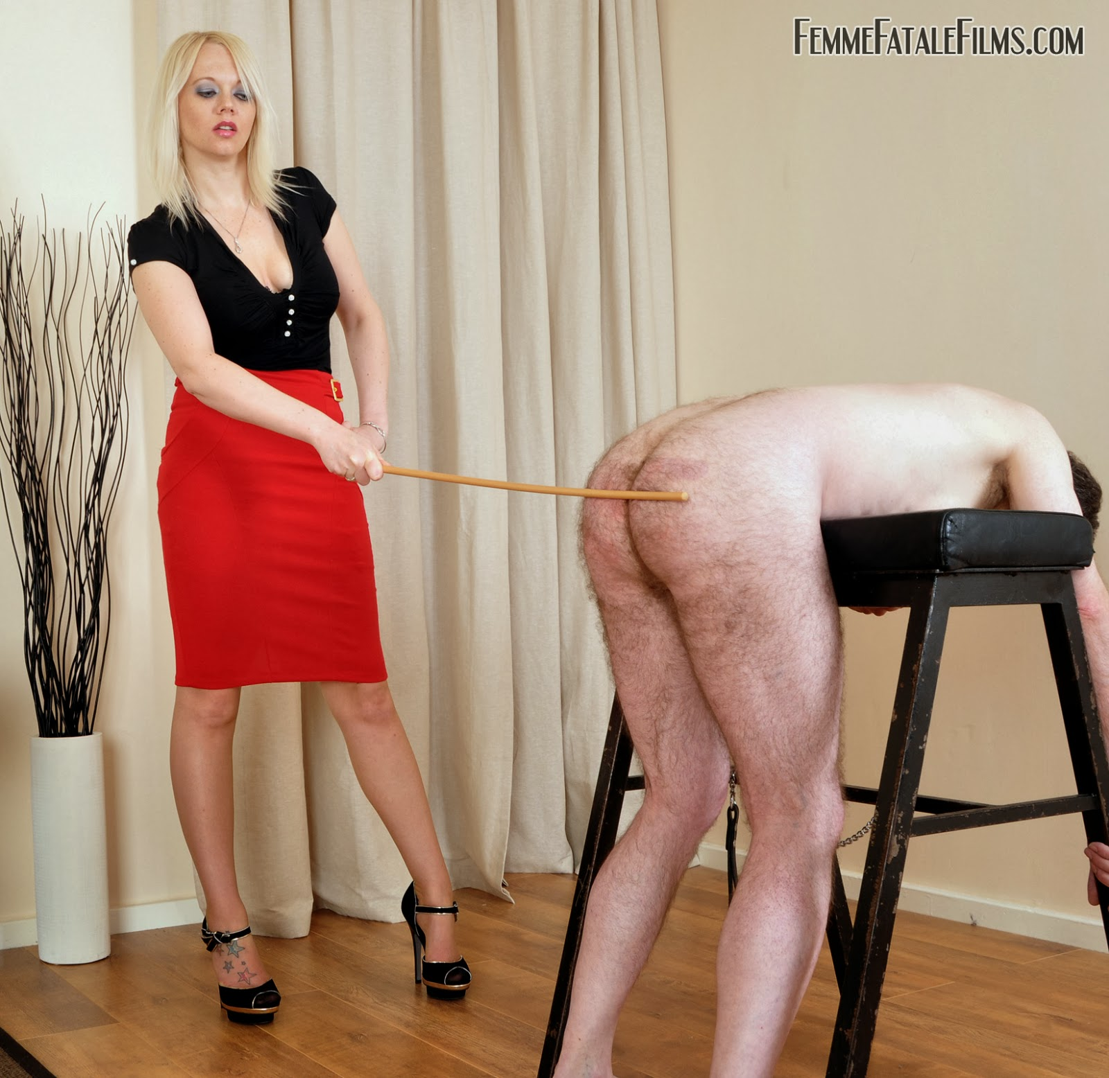 Mistress is beating male slave 9