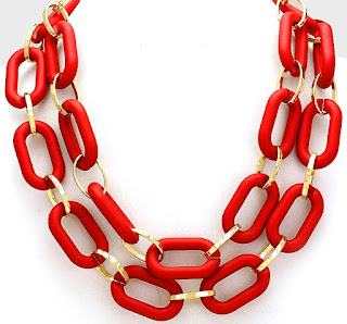 http://www.jaebee.com/products/red-and-gold-large-oval-loop-necklace