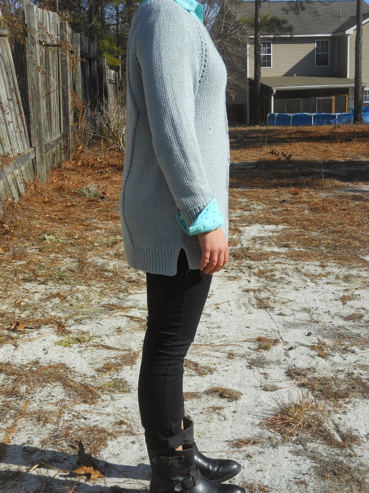 Pops of Blue. Grey oversized sweater, polka dot button down, black jeans, black ankle boots, feminine jewelry.