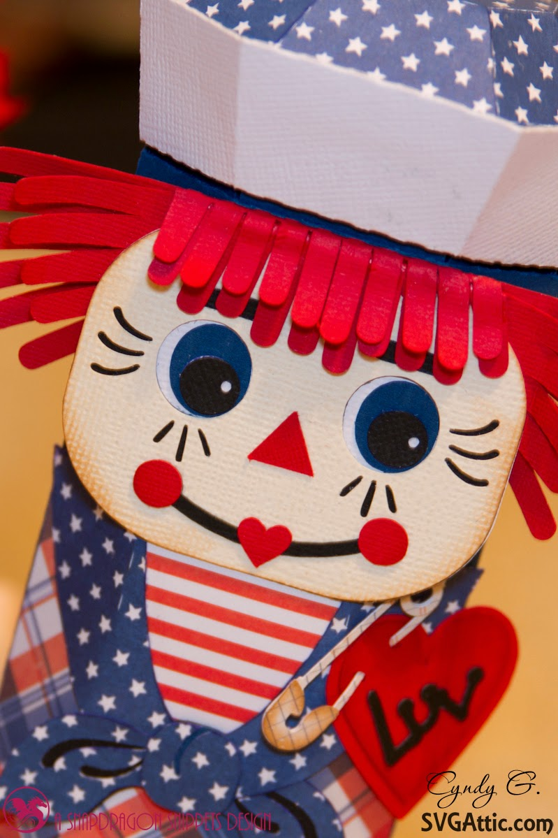 close up of Raggedy Andy's face and pinned on heart