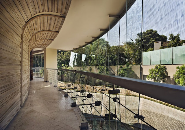 Photo of curved glass wall on the hallway of first floor
