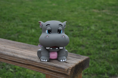 plastic rhinocerous sitting on deck