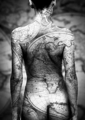 Adorableness world map full body tattoo