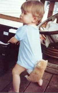 funny picture: child with kitten