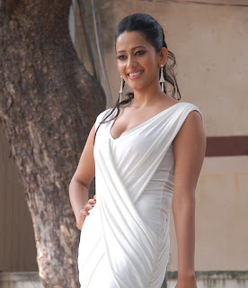 Sanjana Singh Spicy Pictures wearing a Spicy White Gown