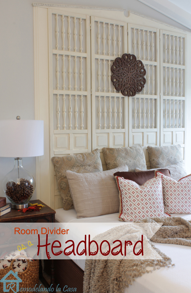wood screen repurposed as headboard in master bedroom.