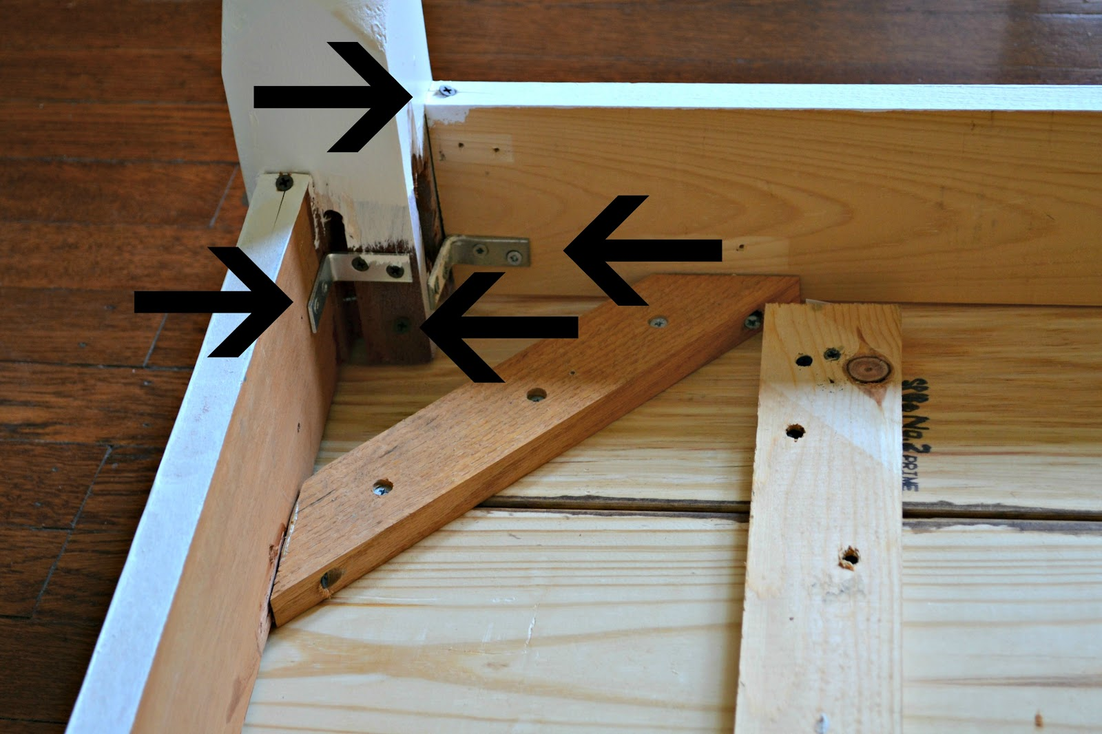 To Also Add Stability, I Drilled Holes And Inserted Screws From The Legs,  At An Angle Into The Table Top, Shown With The Bottom Arrow In The Photo  Below.