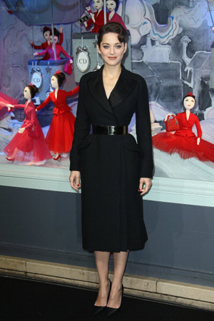 Marion Cotillard in front of Dior Christmas decorations at Printemps, Paris