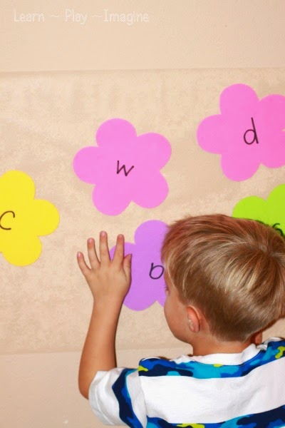 Alphabet sticky wall - preschool activity for spring