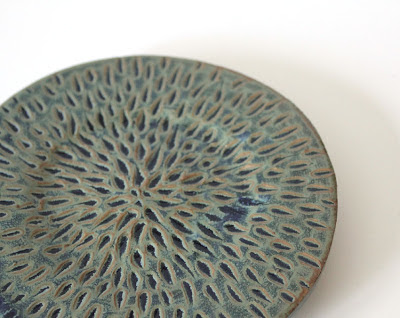 carved and glazed pottery plate