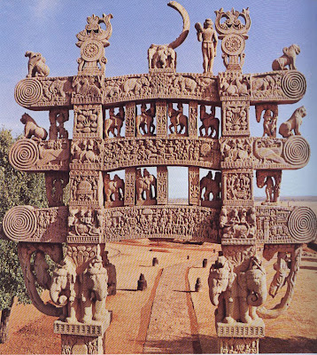 The north gate of the Buddhist stupa at Sanchi. The sculptures, which date from the first century B.C., are of subjects from the Jatakas the myths which relate to Buddha's previous lives on earth. The great hemispherical domes called stupas were raised to honour the resting places of Buddha's relics.