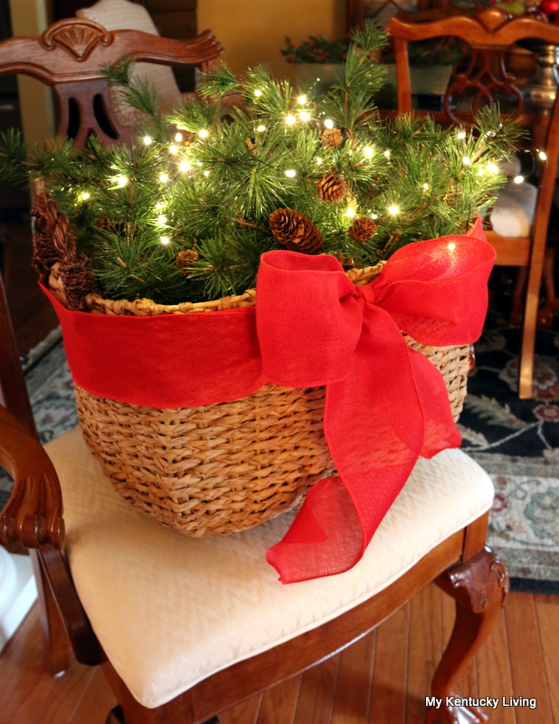 here is one of my baskets that i dolled up for christmas it is a super simple decoration but it adds lots of christmas spirit to the house