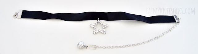 Born Pretty Store sells this black leather star pendant choker for just $3, a wonderful price for the quality.