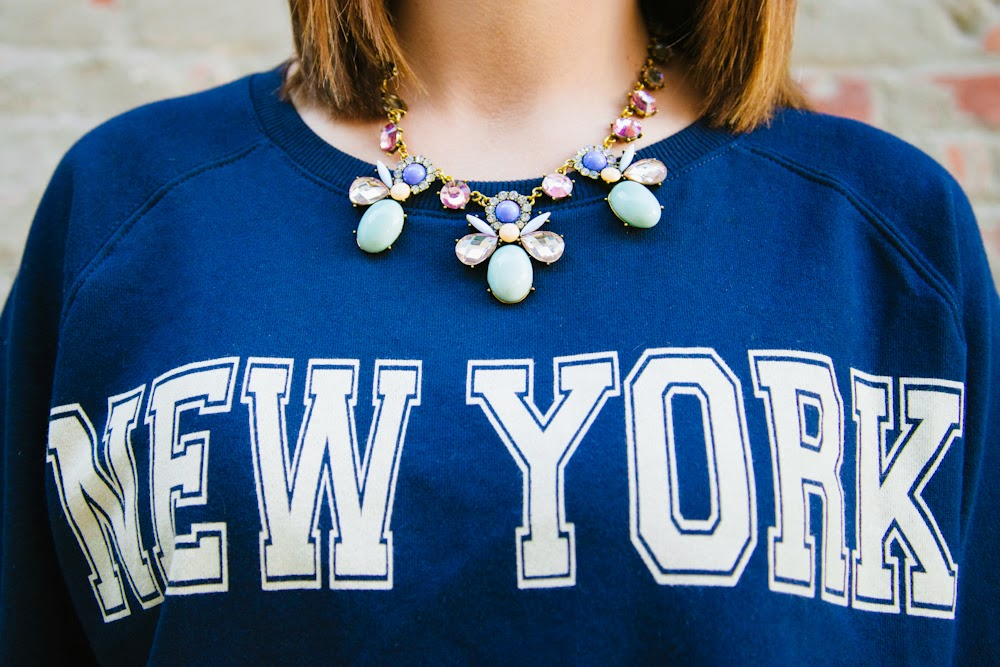 statement jewelry with simple shirt