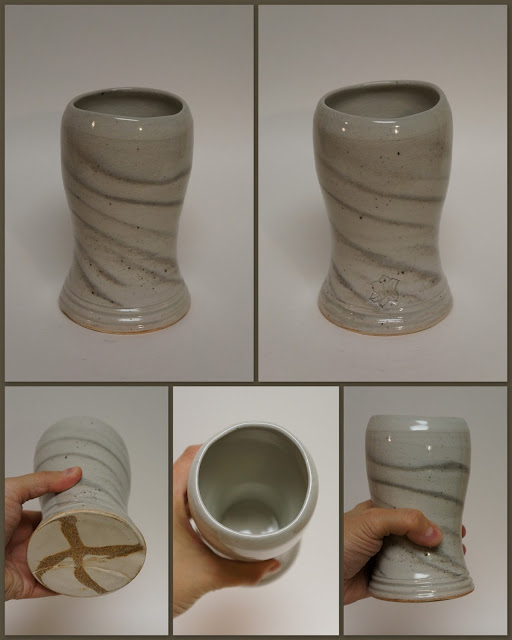 Ceramic pottery beer weisen mug cup with marbled design.