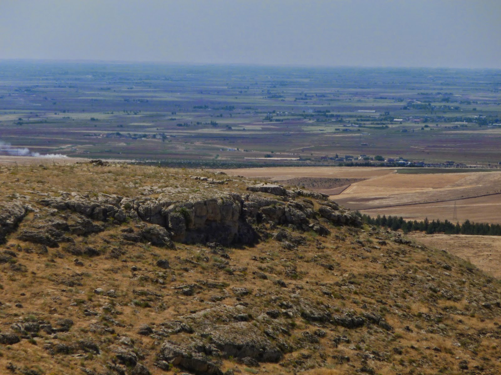 From a hill near Urfa, Turkey, the picture looks off into the misty distance of thre Syrian border.
