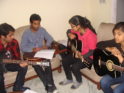 ANANDAM MUSIC SCHOOL-TARUN RAWTANI TEACHING GUITAR