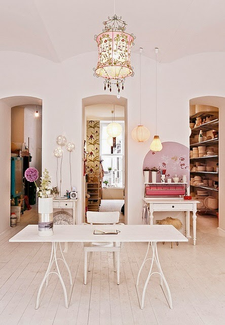 open feminine pink and white office design