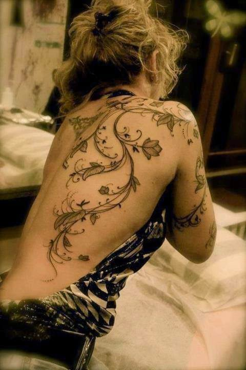 Amazing flower design tattoo on back and arms