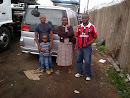 Tami with Mr and Mrs Shoko from Zim after they bought a used Japanese Nissan Elgrand in Durban