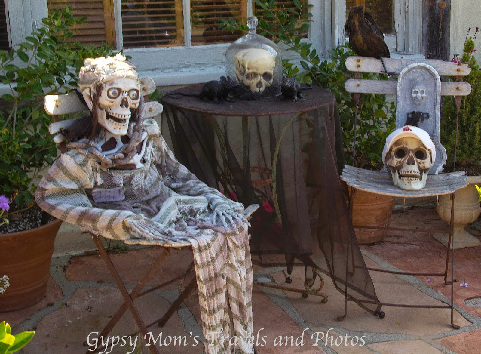 Skeletons on front porch of house on Balboa Island
