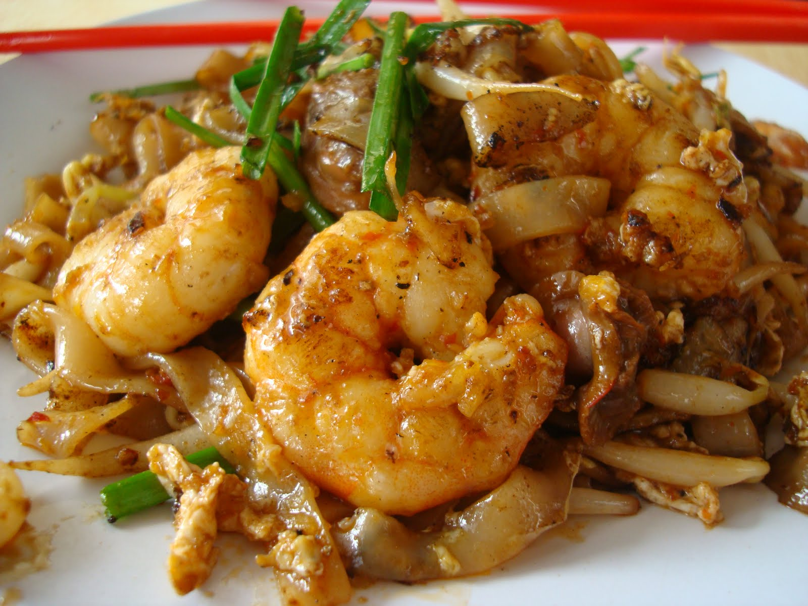 char kway teow literally stir fried ricecake strips is a popular ...